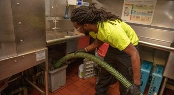 Employee grease pumping at a restaurant